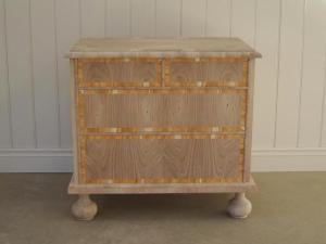 The first chest of drawers is typical of small four-drawer William and Mary chests made around 1695. The carcase is made of pine and veneered with walnut, and the drawer fronts are additionally crossbanded with yew. Jack Plane.