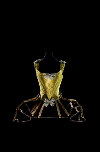 Whalebone corset. France, ca. 1740–60. Silk satin damask, braided silk, linen bows covered in silk and decorated with metallic thread, whalebone, linen lining. Les Arts Décoratifs, collection Mode et Textile, PR 995.16.1. Articulated pannier. France, ca. 1770. Iron covered with leather, fabric tape. Les Arts Décoratifs, depot du musée national du Moyen Âge-Thermes et hotel de Cluny 2005, Cluny 7875. Photographer: Patricia Canino.