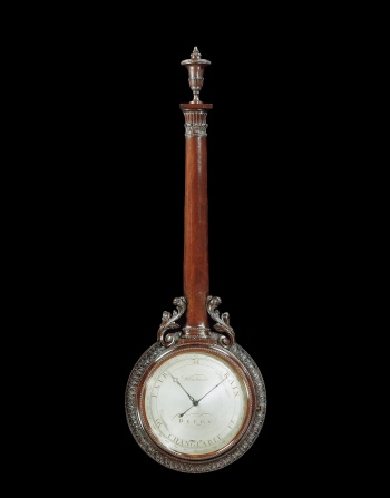 Wheel barometer, ca. 1770–80, 43 × 14 × 2.25 inches. Dial, silvered, signed 'Whitehurst Derby' with 3-inch scale for 29-31 inches of mercury subdivided into hundredths and inscribed for changeable, rain, fair. Case: mahogany, carved with leaves, column (housing the tube) with acanthus leaves at base, and urn finial. Made by Whitehurst of Derby.