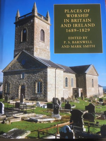 Front cover of the bookjacket, with a photograph of a church and cemetery.